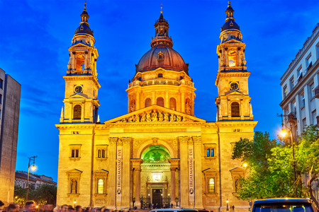 nightime: BUDAPEST,HUNGARY-MAY 05, 2016:St.Stephen Basilica in Budapest at nightime,people on square near Basilica.