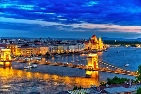 szechenyi: Szechenyi Chain Bridge and Parliament at dusk. Budapest, Hungary.