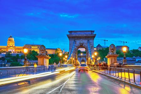 szechenyi: Budapest Royal Castle and Szechenyi Chain Bridge at dusk time. Hungary.