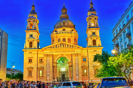 nightime: BUDAPEST, HUNGARY-MAY 05,2016: St. Stephen Basilica in Budapest at nightime and sport car show with peoples.