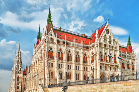 BUDAPEST, HUNGARY-MAY 02, 2016: People near Hungarian Parliament close-up. Budapest. One of the most beautiful buildings in the Hungarian capital.
