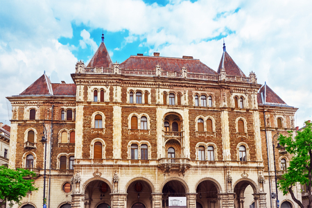 hungarian: BUDAPEST, HUNGARY, - MAY 02, 2016: Dreschler Palace-gorgeous building in front of the Opera in Budapest, people, cars on street. Hungary. Editorial