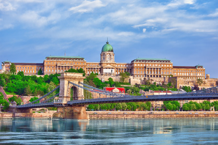 szechenyi: Budapest Royal Castle and Szechenyi Chain Bridge at day time from Danube river, Hungary.