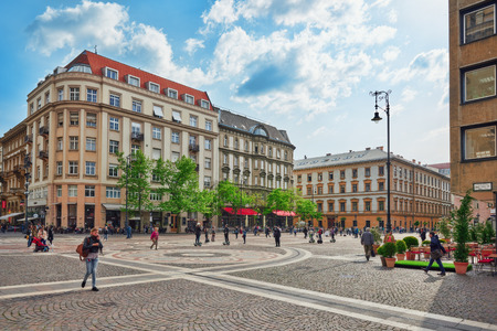 stephen: BUDAPEST,HUNGARY-MAY 02, 2016:City square  near St.Stephen Basilica in Budapest at daytime, people on near Basilica.Hungary.