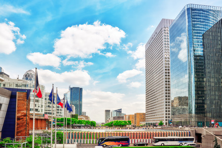 PARIS, FRANCE - JULY 06, 2016 :La Defense, Business Quarter with businessmen in the streets, area of Paris,  French financial center with skyscrapers and modern buildings. Editorial
