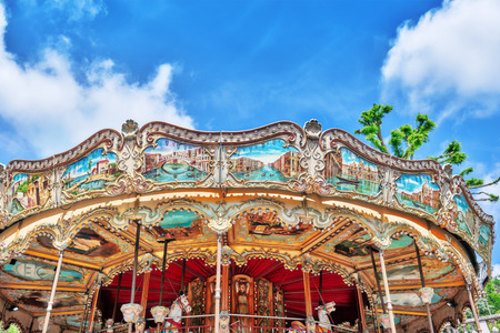 round chairs: Entertainment Carousel for the youngest children. Horses on a carnival.