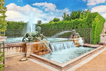 Fountain with lions in a beautful and Famous Gardens of Versailles (Chateau de Versailles).