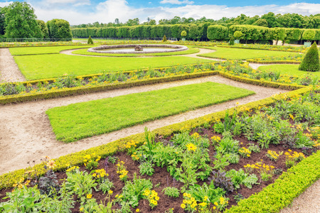 shrubbery: Grand Trianon gardens is famous French-style gardens �filled with all sorts of orange blossoms, green shrubbery.