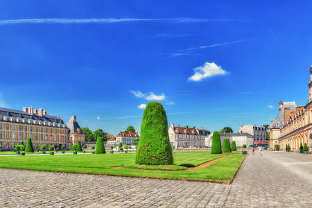 FONTAINEBLEAU, FRANCE - JULY 09, 2016 : Suburban Residence of the France Kings - beautiful Chateau Fontainebleau and surrounding his park. Editorial