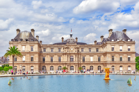 PARIS, FRANCE - JULY 08, 2016 : Children float  boats in the fountain Luxembourg Palace and park in Paris, Jardin  one of the most beautiful gardens in Paris. France.