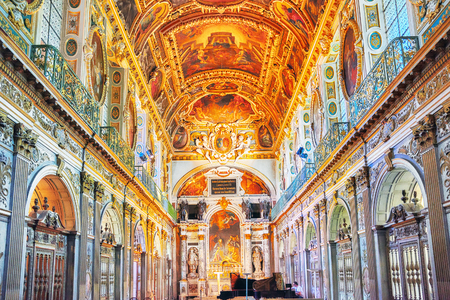 FONTAINEBLEAU, FRANCE - JULY 09, 2016 : Fontainebleau Palace interiors. The Trinity Chapel. Chateau was one of the main palaces of French kings.