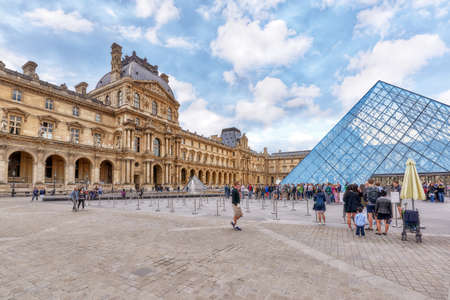 PARIS, FRANCE - JULY 03, 2016 :Glass pyramid and the Louvre museum. The Louvre is the biggest museum in word with nearly 35,000 historical artefacts.
