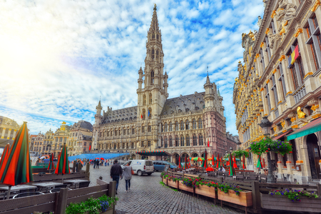 BRUSSELS, BELGIUM - JULY 07, 2016 : Citys Town Hall on Grand Place (Grote Markt), the central square of Brussels. It is surrounded by opulent guildhalls and two larger edifices.