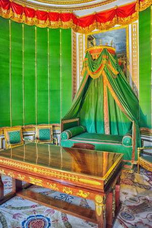 bedchamber: FONTAINEBLEAU, FRANCE - JULY 09, 2016 : Fontainebleau Palace interiors. The Emperors small Bedchamber. Chateau was one of the main palaces of French kings. Editorial