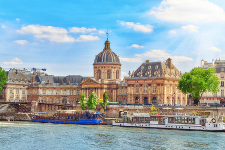 seafronts: Mazarin Library (Bibliotheque Mazarine) and  Bridge of the Arts ( Pont des Arts) in Paris. France. Editorial