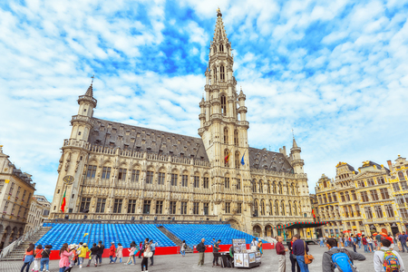 BRUSSELS, BELGIUM - JULY 07, 2016 : Citys Town Hall on Grand Place (Grote Markt), the central square of Brussels with tourists. It is surrounded by opulent guildhalls and two larger edifices. Editorial