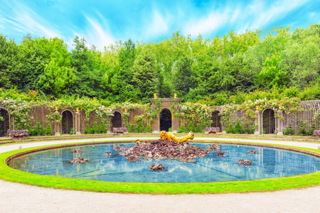 VERSAILLES, FRANCE - JULY 02, 2016 : Escalade fountain in a beautiful park in Europe - Versailles. France