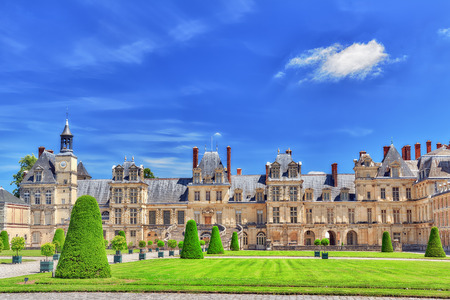 FONTAINEBLEAU, FRANCE - JULY 09, 2016 :  Suburban Residence of the France Kings - facade  beautiful Chateau Fontainebleau and surrounding his park.