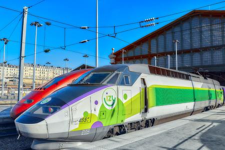 france station: PARIS, FRANCE - JULY 07, 2016 :  Modern speed passenger train on railways station Gare De Nord ( Nothern Railways Station) in Paris. Editorial