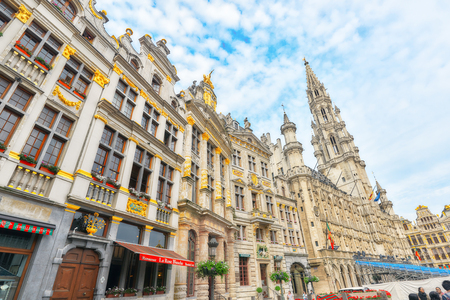 opulent: BRUSSELS, BELGIUM - JULY 07, 2016 : Citys Town Hall on Grand Place (Grote Markt), the central square of Brussels. It is surrounded by opulent guildhalls and two larger edifices.