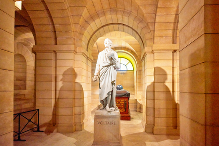 pendulum: PARIS, FRANCE - JULY 05, 2016 : Statue of the great French writer - Voltaire in the basement near the Pantheon French writer coffin. Paris.