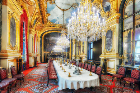 PARIS, FRANCE - JULY 03, 2016 :  Apartments of Napoleon III. Large dining room. Louvre Museum is the biggest museum in word with nearly 35,000 exhibits.