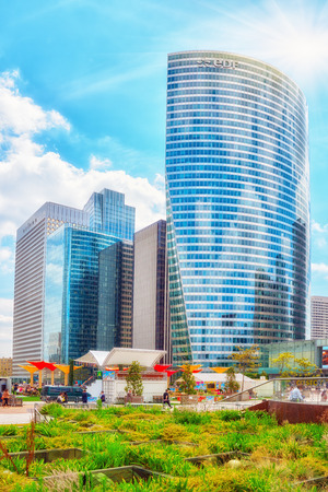 archways: PARIS, FRANCE - JULY 06, 2016 :La Defense, Business Quarter with businessmen in the streets, area of Paris,  French financial center with skyscrapers and modern buildings. Editorial