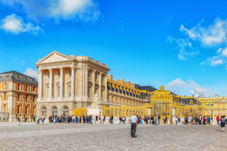 VERSAILLES, FRANCE - JULY 02, 2016 : Head (main) entrance with  the people ( tourists)  in the Versailles Palace. Versailles, France. Sajtókép