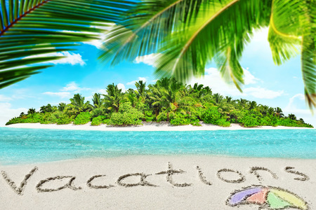 Whole tropical island within atoll in tropical Ocean. Uninhabited and wild subtropical isle with palm trees. Inscription Vacations in the sand on a tropical island,  Maldives.