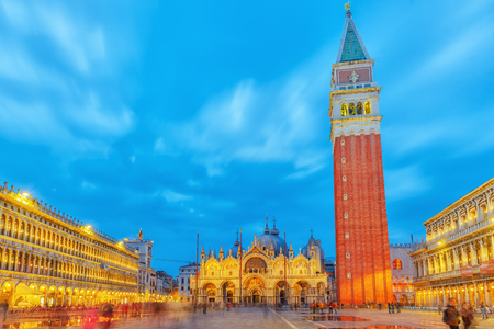 Square of the Holy Mark (Piazza San Marco) and St. Marks Cathedral (Basilica di San Marco) at the night time. Venice. Italy.