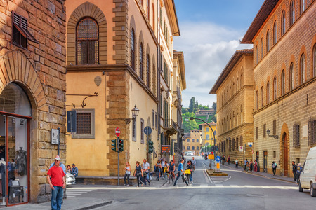 FLORENCE, ITALY- MAY 14, 2017:  Beautiful landscape  urban and historical view of the Florence - the city of the Renaissance on Arno river, street,tourists on it. Italy.