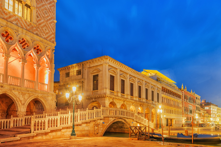 Embankment of the Grand Canal and the Doges Palace (Palazzo Ducale) in night time, Venice. Italy. Editorial