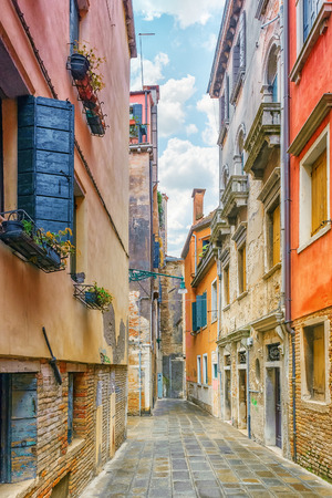 View of the most beautiful places of Venice, narrow streets, houses, city squares. Italy.