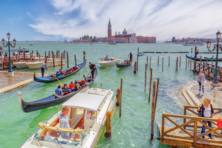 venice: VENICE, ITALY - MAY 12, 2017 : Embankment of the Grand Canal with Gondolas and Gondoliers. Italy. Editorial