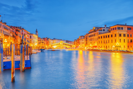 rialto: Views of the most beautiful canal of Venice - Grand Canal water streets, boats, gondolas, mansions along. Night view. Italy. Stock Photo