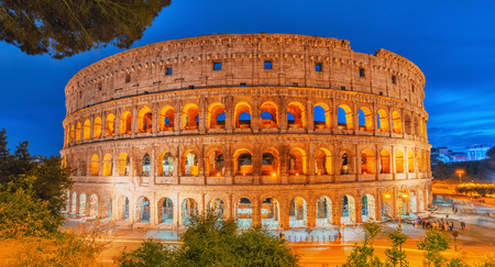 Beautiful landscape of the Colosseum in Rome- one of wonders of the world  in the evening time. Italy. Stock Photo