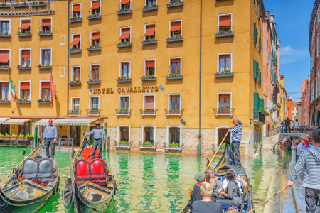 venice: VENICE, ITALY - MAY 12, 2017 : Views of the most beautiful channel of Venice, narrow streets, houses, gondolas and gondoliers with tourists. Italy.