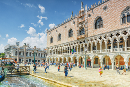 venice: VENICE, ITALY - MAY 12, 2017 : Embankment of the Grand Canal with tourists and the Doges Palace (Palazzo Ducale) , Italy.