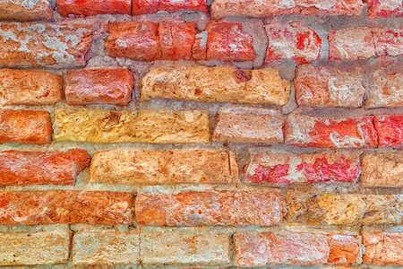 Texture of a brick wall made from an old red bricks. Picture taken in Venice.