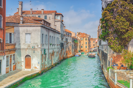 VENICE, ITALY - MAY 12, 2017 : Views of the most beautiful channels of Venice, narrow streets, houses.Italy.