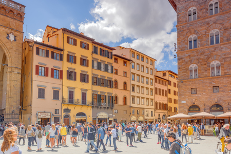 FLORENCE, ITALY- MAY 13, 2017: Square of Signoria (Piazza della Signoria) L-shaped square in front of the Palazzo Vecchio palace in Florence with tourists. Italy.