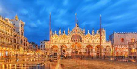 Square of the Holy Mark (Piazza San Marco) and St. Marks Cathedral (Basilica di San Marco) at the night time. Venice, Italy. Imagens