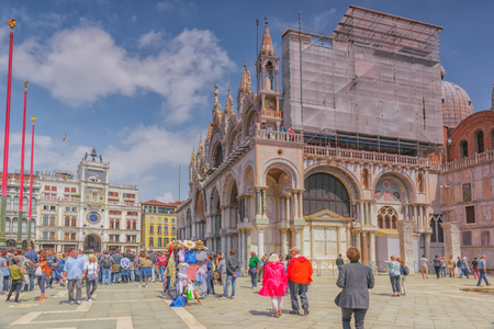 VENICE, ITALY - MAY 12, 2017 : Square of the Holy Mark (Piazza San Marco) and St. Marks Cathedral (Basilica di San Marco) with tourists, Italy.