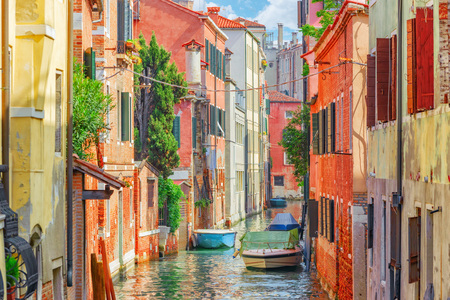 Views of the most beautiful channels of Venice, narrow streets, houses.Italy.