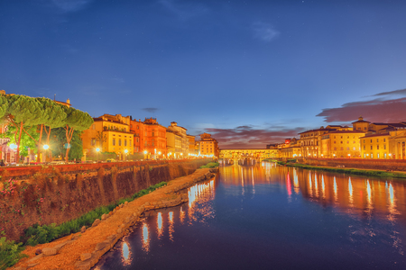 Beautiful landscape, panorama on historical view of the Florence - Ponte Vecchio is a bridge in Florence at night time. Italy. Stock Photo