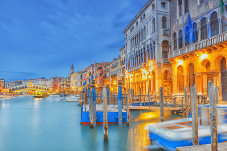 Views of the most beautiful canal of Venice - Grand Canal water streets, boats, gondolas, mansions along. Night view. Italy. Stock Photo