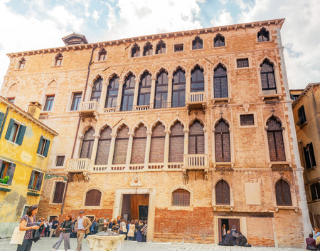 VENICE, ITALY - MAY 12, 2017 : People near  Palazzo Fortuny (also known as Palazzo Pesaro degli Orfei)-  is an art museum in San Marco, Venice.  Italy.