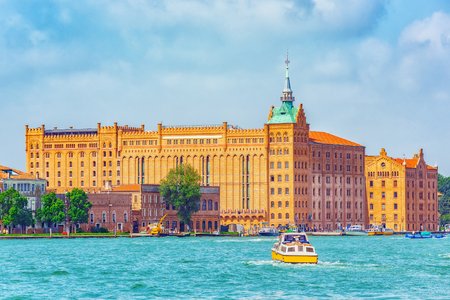 A view of the island of Giudecca, located opposite main island Venice. Building of Hilton Molino Stucky Venice. Italy.