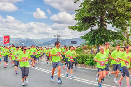 scamper: FLORENCE, ITALY - MAY 14, 2017 : Sporting event in Florence, Deejay Ten – Run like a deejay on May 14, an event organized by the company Radio Deejay. It involves running 5 or 10 km through the streets of Florence .Italy.
