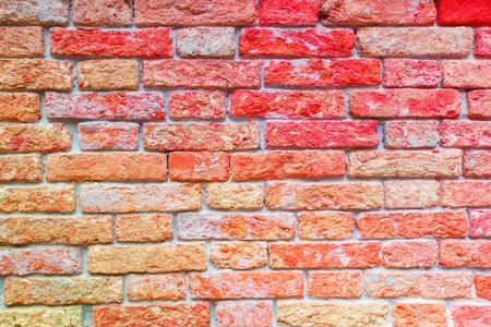 De textuur van een bakstenen muur maakte van oude rode bakstenen. Foto genomen in Venetië.